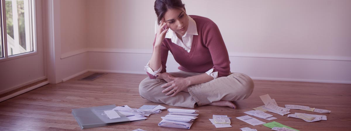 Woman with CRA debt facing financial statements