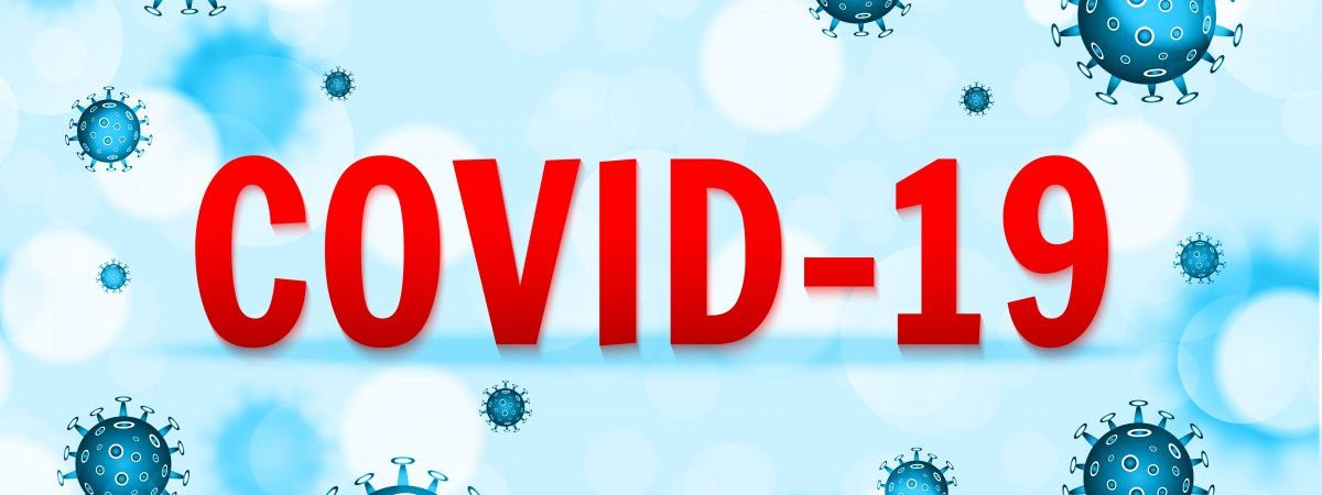 covid-19 red text in the middle of illustrations of the virus on a blue background